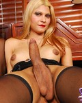 Blonde Elisa in stockings showing her huge cock