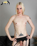 Christina Skyye Beautiful blonde tgirl in tattoos strips for your pleasure!